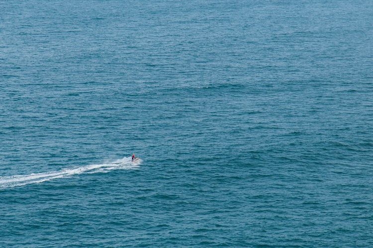 High angle view of person riding jet boat in sea