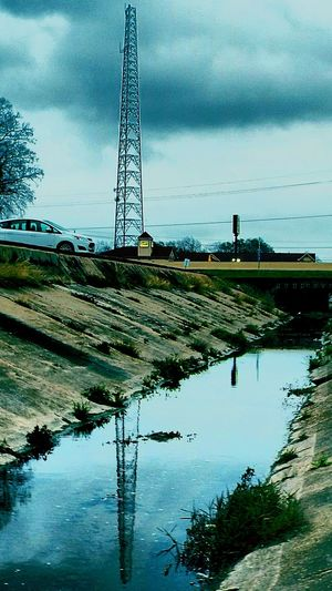 On The Bayou Drainageditch Reflection Of Satellite Tower In The Ditchwater Dusk Gloomy Days Colour Your Horizn