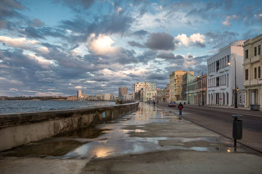 Maceo's Avenue or Malecón is a roadway and sea wall that stretches 5 miles in Havana Cuba. Havana Cuba Travel Streetphotography Architecture Building Exterior Built Structure Water Sky Cloud - Sky City People Travel Destinations Beach