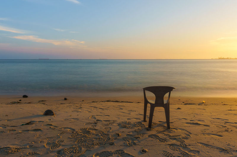 Empty chair waiting for sunset moment Beach Beauty In Nature Cloud - Sky Horizon Horizon Over Water Idyllic Land Nature No People Remote Sand Scenics - Nature Sea Seat Sky Sunset Tranquil Scene Tranquility Water