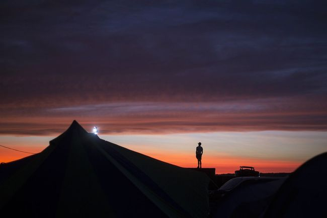 Sunset One Person Travel Silhouette Pyramid Sunset Travel Destinations One Man Only Standing Sky Night Outdoors Festival Festival Season Music Festival Bell Tent Glamping Glampercamper Dusk Dusk Colours