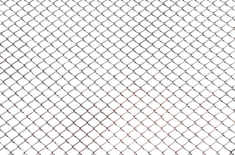 Full frame shot of chainlink fence against white background