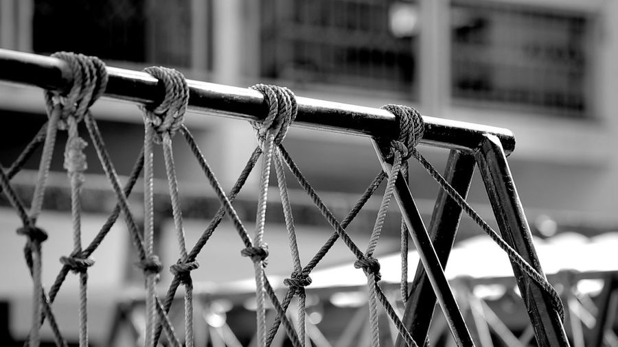 Roped Barbed Wire Chainlink Fence Close-up Day Detail Fence Focus On Foreground Metal Metallic Nature No People Outdoors Part Of Protection Safety Security Selective Focus Sky Fine Art Photography Pattern