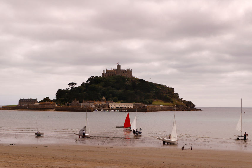 An overcast day at Saint Michael's Mount at Marazion near Penzance in Cornwall, England Travel Travel Photography Architecture Beach Beauty In Nature Building Building Exterior Built Structure Cloud - Sky Day Island Land Mode Of Transportation Nature Nautical Vessel Outdoors Sailboat Scenics - Nature Sea Sky Tourist Destination Transportation Travel Travel Destination Water