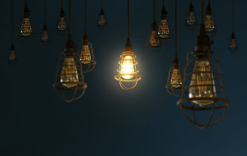 Low angle view of illuminated hanging light bulbs