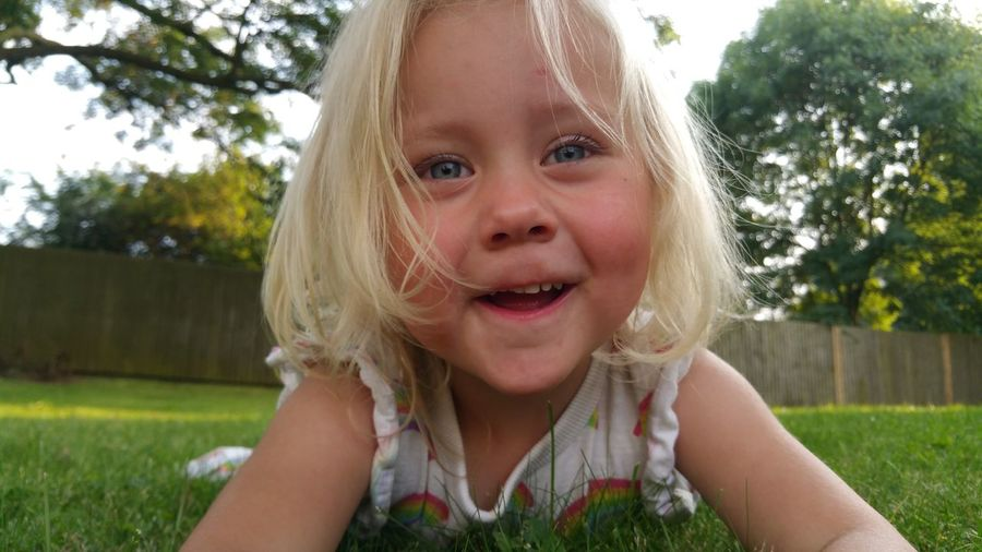 EyeEm Selects Blond Hair Portrait Child Tree Childhood Girls Headshot Looking At Camera Summer Front Or Back Yard