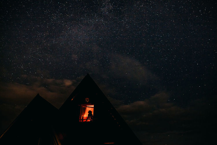 woman in house with stars view at night. Night life EyeEm Best Shots Females Night Life Nightphotography Sky And Clouds Travel Woman Architecture Astronomy Building Exterior House Night Nightlife Outdoors Relax Sky Space Space And Astronomy Star - Space Star Field Stars