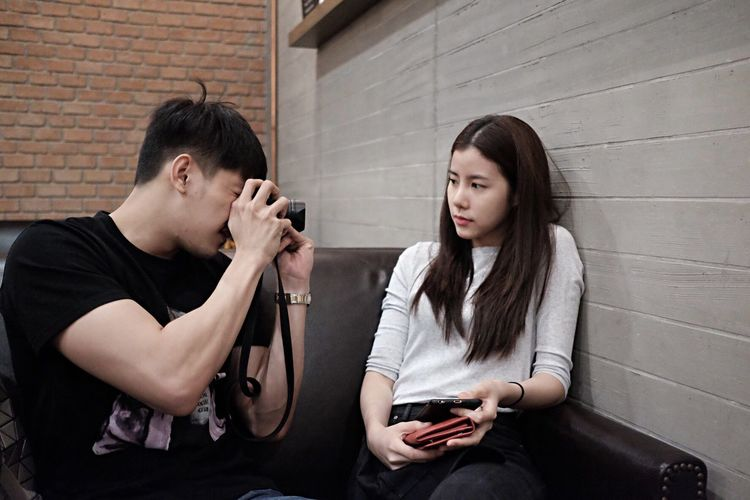 Man Photographing Woman Though Camera