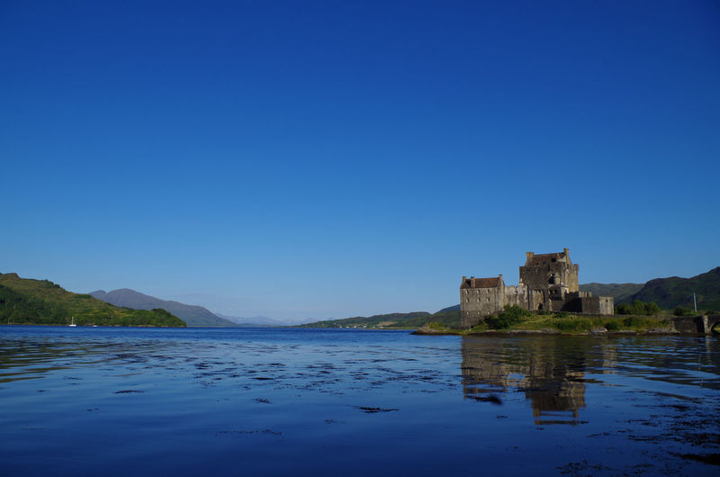 Eilean Donan Castle Eilean Donan Castle Scotland Scottish Highlands Water Ancient Civilization Blue Old Ruin Castle History Clear Sky Reflection Sky Architecture Medieval Aged Fort Destinations Fortress My Best Photo British Culture