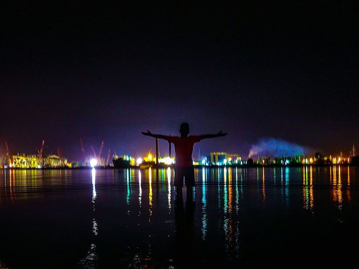 Water Tranquility Men Night Nature One Person Standing People Silhouette Beauty In Nature Adult Outdoors Sky Only Men One Man Only Adults Only Human Body Part Slow Shutter Nightphotography Night Lights Open Wide Reflection Shipping Containers Shipyardlife EyeEm Best Edits EyeEmNewHere
