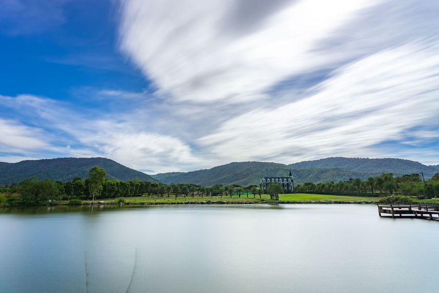 Cloud - Sky Sky Mountain Water Scenics - Nature Beauty In Nature Nature Tranquil Scene Day No People Waterfront Tranquility Lake Mountain Range Non-urban Scene Plant Tree Built Structure Outdoors