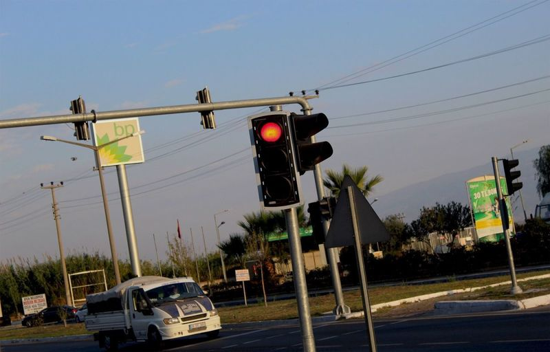 Traffic signal on road against sky