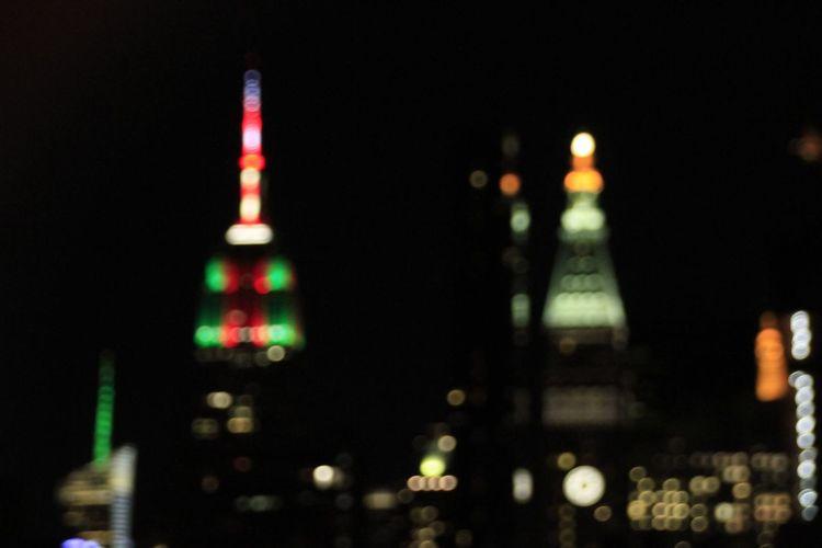 Defocused image of illuminated buildings at night