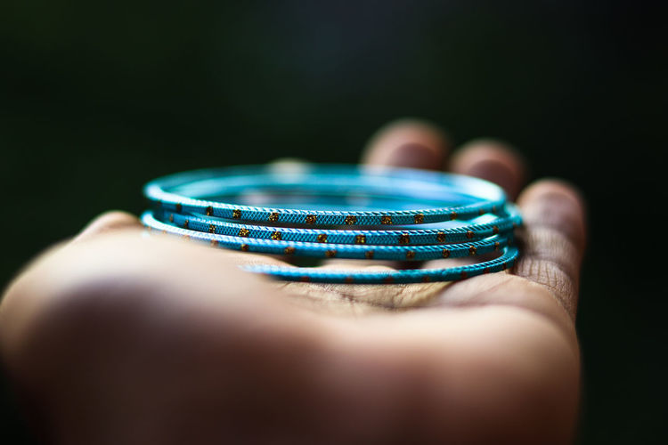 she loves bangles Beautiful New Hand Palm Bokeh Blue Bangles No People Day Indoors  50mm Canon Focus EyeEm Selects Human Hand Black Background Close-up Gemstone  Jewelry Semi-precious Gem The Photojournalist - 2018 EyeEm Awards A New Beginning