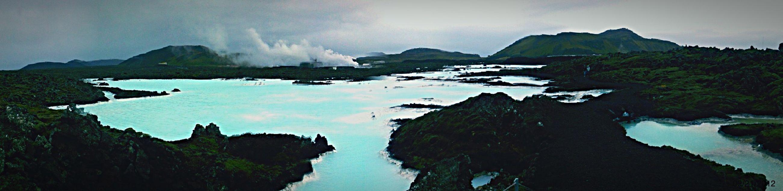 water, sky, mountain, scenics, tranquil scene, tranquility, rock - object, beauty in nature, cloud - sky, sea, nature, rock formation, lake, reflection, cloud, idyllic, mountain range, waterfront, rock, non-urban scene
