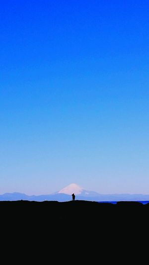 Scenic View Of Field And Mount Fuji Against Clear Blue Sky