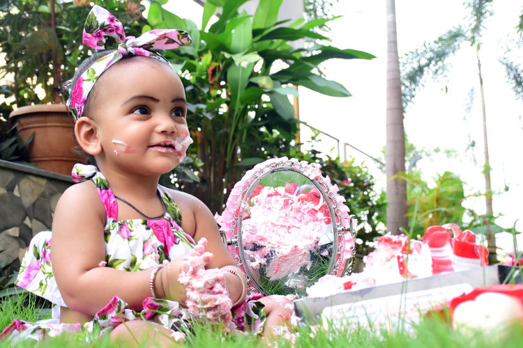 Portrait of cute girl with pink flower