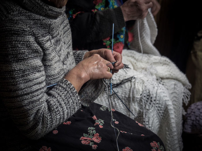 Cloth Craft Domestic Fashion Female Grandmother Hand Handcrafted Handmade Hands Hobby Homemade Knit Knitting Needles Lifestyle Making Needle Needlework Old Woman Senior Sitting Thread Traditional Vintage Warm Winter Woman Wool Woolen Yarn