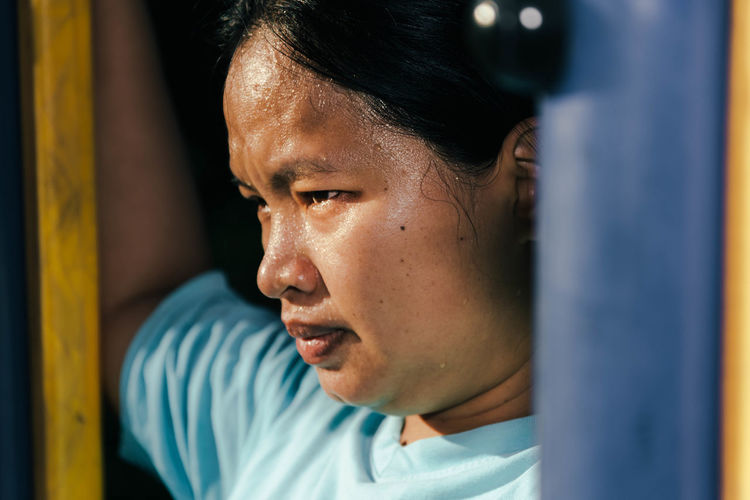Close-up of sweaty woman looking away