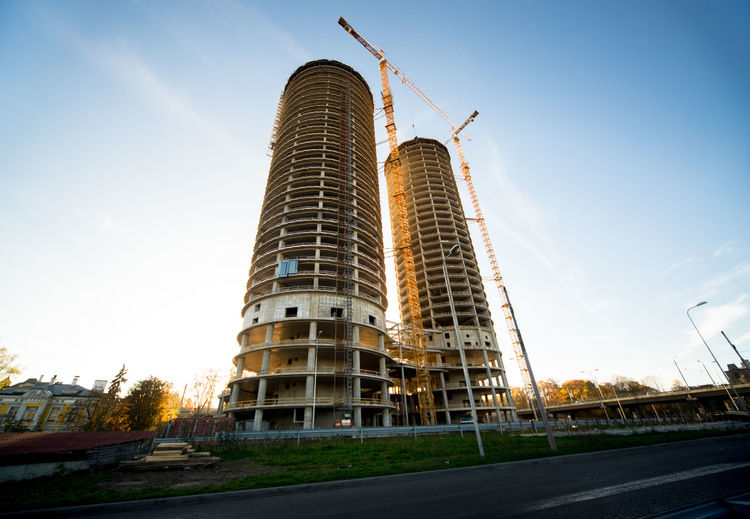 Low Angle View Of Incomplete Buildings Against Sky