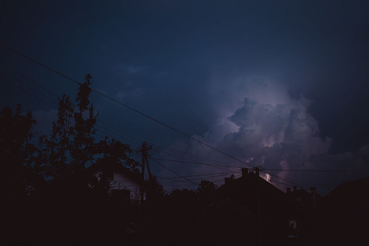 Storm Stormy Weather Air Pollution Architecture Beauty In Nature Built Structure Cable Cloud - Sky Connection Dusk Electricity  Electricity Pylon Low Angle View Nature No People Outdoors Plant Pollution Power Line  Power Supply Silhouette Sky Storm Cloud Storm Clouds