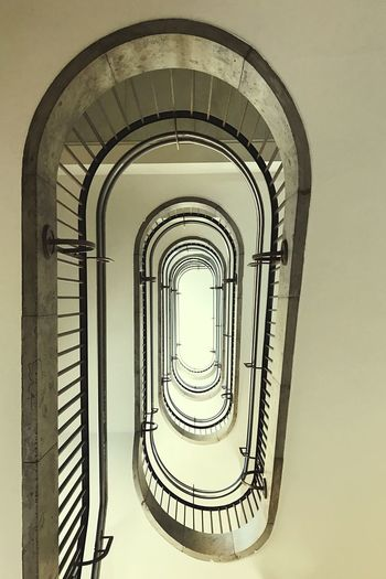 Staircase Steps And Staircases Spiral Steps Railing Architecture Spiral Stairs Stairs Built Structure In A Row Hand Rail No People Low Angle View Spiral Staircase Day NEM Architecture EyeEm Masterclass Shootermag Mobilephotography Eye4photography  Ceiling Indoors