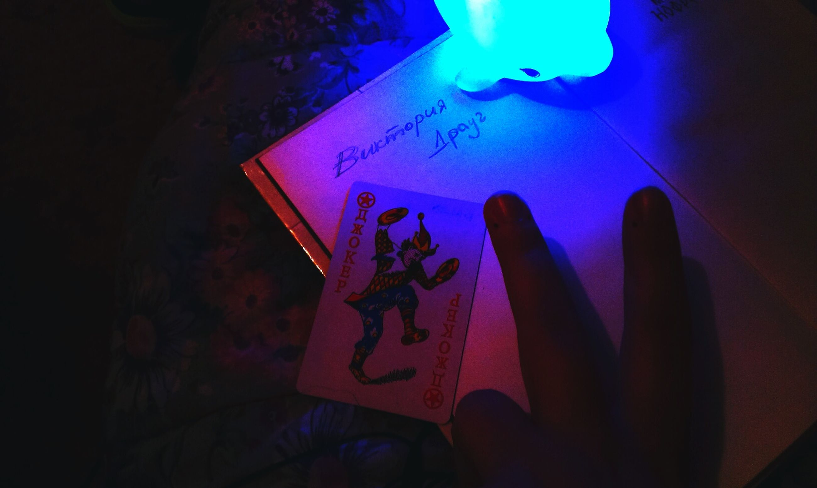 indoors, person, text, illuminated, communication, paper, part of, human finger, close-up, holding, western script, unrecognizable person, cropped, creativity, art, night, men