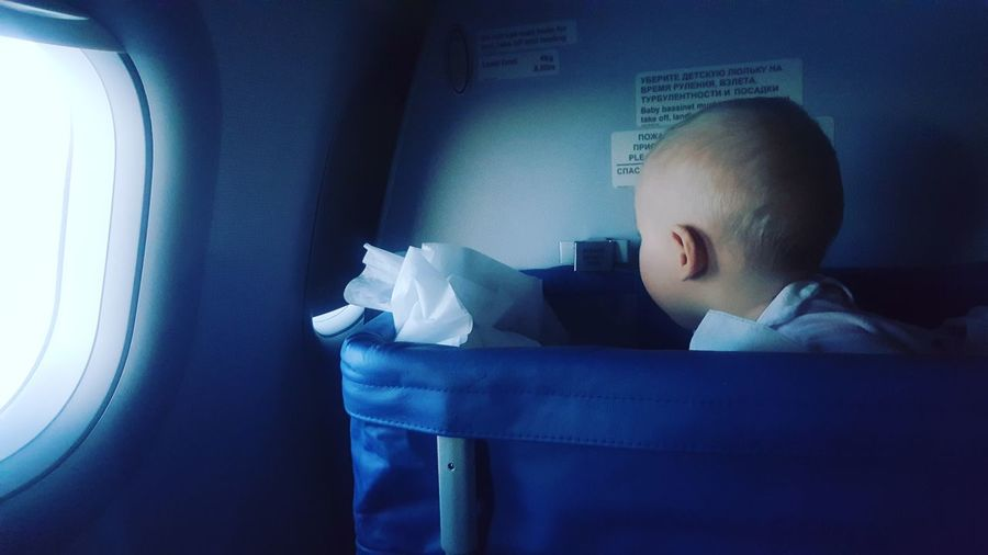 baby in a cradle in a plane Baby Plane Travel Trip Family Trip Adult