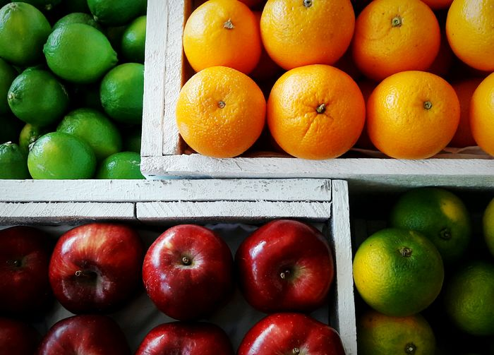 High angle view of fruits in containers at market for sale