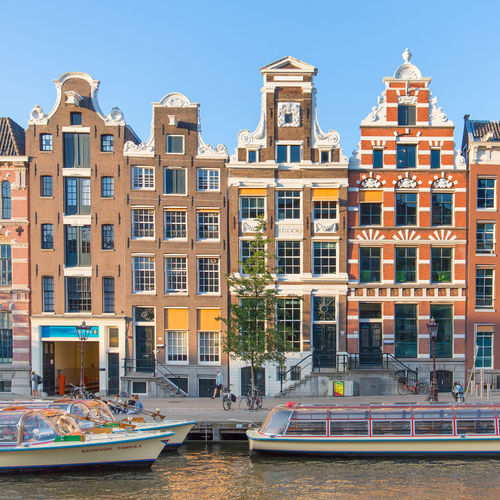 Amsterdam Netherlands Apartment Architecture Building Building Exterior Built Structure Canal Canal Houses City Day Dutch Architecture Dutch Houses Holland In A Row Luxury Mode Of Transportation Moored Nature Nautical Vessel No People Outdoors Passenger Craft Residential District Rokin Row House Sky Transportation Water Waterfront Window