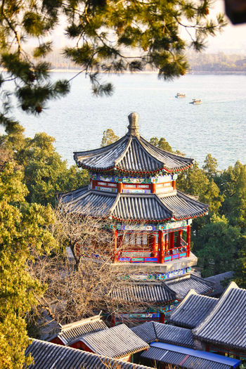 China Beijing Summer Palace China Sommerpalast Bejing Bejing Summer Palace Old A Summer Retreat For Imperial Families Aged Building Airy Pavilions Ancient Architecture Beijing Beijing Summer Palace Summer Palace Garden China Capitol Chinese City Color Colour Coloured Explore Golden History Kunming Lake Old Building  Peking  Red Royal Royal Family Summer Palace Tourist Destination Travel Trees In The Foreground Unesco Visitor Attaction World Heritage List Site Yihe Yuan Yiheyuan Tree Plant Built Structure Building Exterior Nature Day No People Roof Place Of Worship Belief Religion Outdoors Growth Gazebo Water Spirituality Shrine