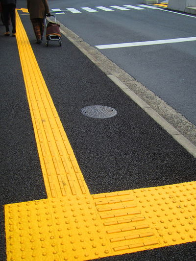 Tactile Paving Asphalt Barrier Free Blind Bright Colors Bumpy Bumpy Paving Bumpy Road Day Disability  Disability Awareness Japan Japanese Street Outdoors Road Tactile Paving Tactile Paving For The Blind Visually Impaired Yellow Color Access Disabled Access Disabled Feel Feel Your Way Let's Go. Together. EyeEm Selects Paint The Town Yellow Colour Your Horizn Stories From The City This Is Aging
