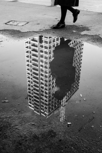 Reflection of the Antwerp A-Tower My Best Travel Photo Reflection Body Part City Day High Angle View Human Body Part Human Foot Human Leg Human Limb Leisure Activity Lifestyles Low Section Men One Person Outdoors Puddle Puddle Reflections Rainy Season Real People Reflection Shoe Standing Streetphotography Water