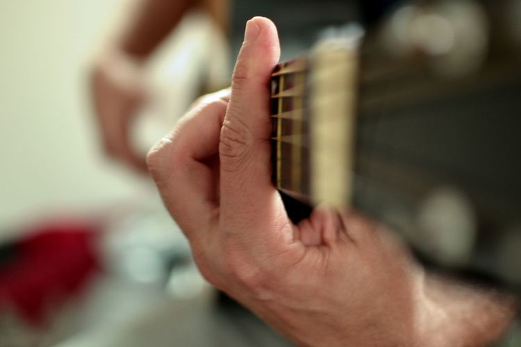 'Listen' to your passion and play like there is no tomorrow Human Hand Hand One Person Indoors  Close-up Selective Focus Focus On Foreground Lifestyles Music Real People Men Holding Musical Instrument Guitarists Hobbies And Passion Musician
