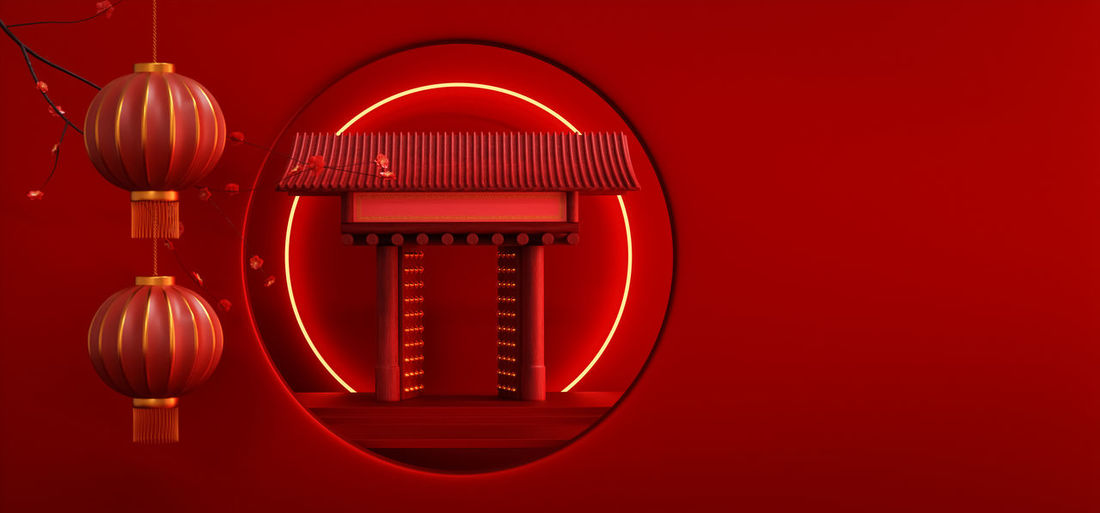 Close-up of illuminated electric lamp against wall
