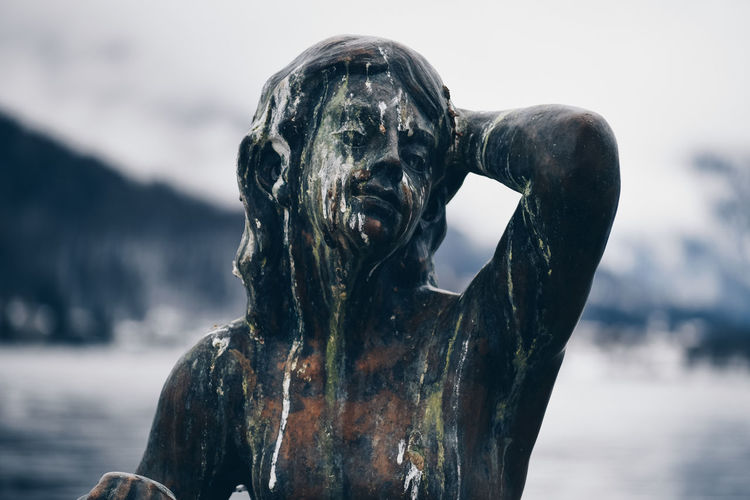 Statue Water Focus On Foreground Nature Day Sea No People Sculpture Representation Art And Craft Outdoors Close-up Metal Statue Statue Relaxing Vacations Bird Poop Pidgin Outdoor Art Art Lake Human Representation Creativity Male Likeness Sky Craft Architecture Running Water