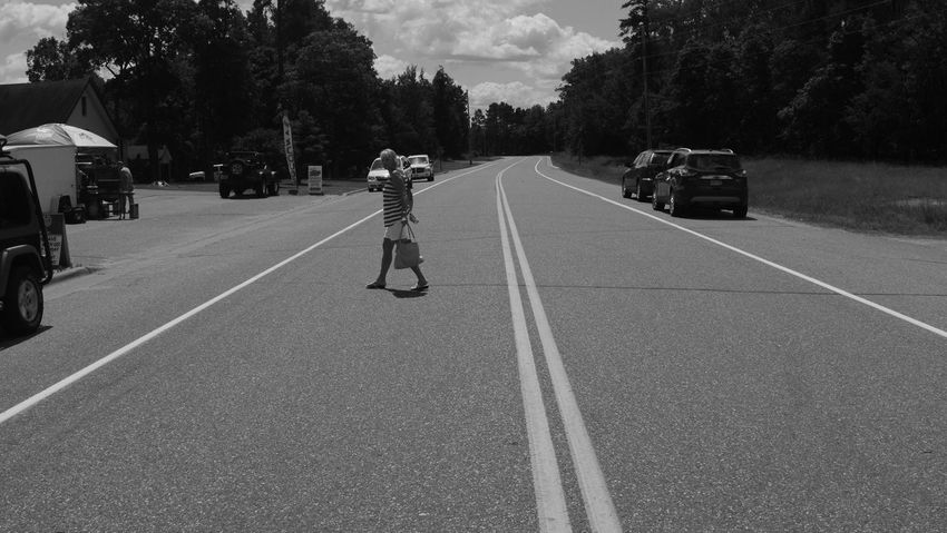 Minnesota Adult Black And White Car Day Full Length Land Vehicle Lifestyles Men Mode Of Transport Monochrome One Man Only One Person Outdoors People Pequot Lakes Real People Rear View Road Road Marking Sky The Way Forward Transportation Tree