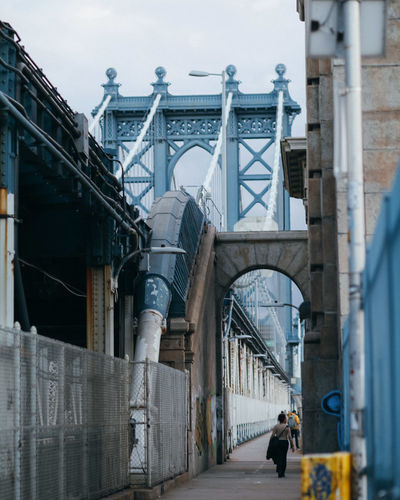 Rear view of woman walking on manhattan bridge