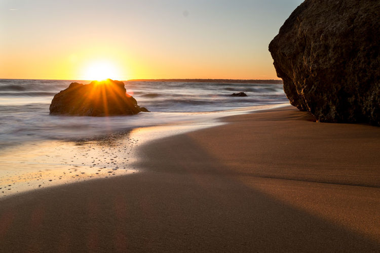 Algarve Portugal Beach Beauty In Nature Clear Sky Cliff Day Horizon Over Water Nature No People Outdoors Rock - Object Sand Scenics Sea Shore Sky Sun Sunbeam Sunlight Sunset Tranquil Scene Tranquility Water Wave My Best Travel Photo