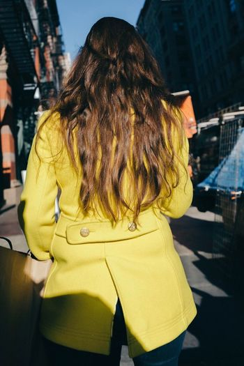 Yellow Rear View Architecture Building Exterior One Person Built Structure Real People Outdoors Long Hair City Day Lifestyles Standing Women Close-up Adult People The Street Photographer - 2017 EyeEm Awards