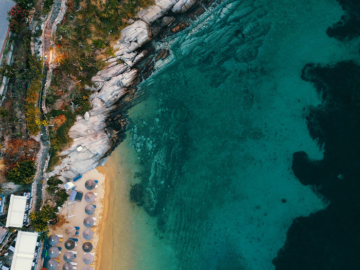 Beach Beauty In Nature Coastline Day Group Of People High Angle View Land Nature Outdoors Plant Rock Rock - Object Scenics - Nature Sea Solid Transportation Turquoise Colored Water