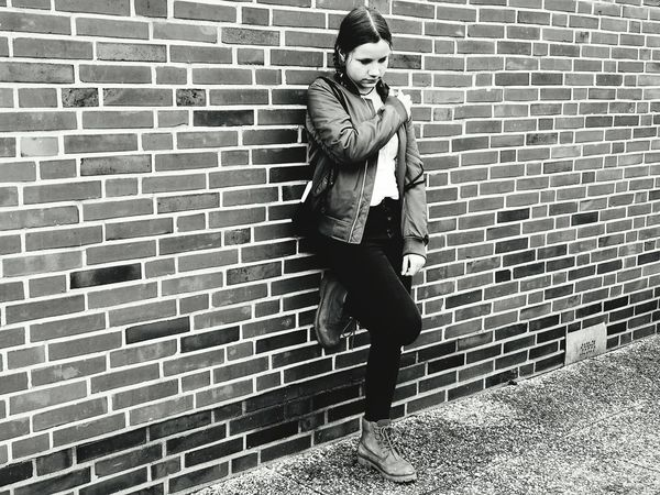 Brick Wall Lifestyles One Person Adult People Outdoors Leisure Activity Fashion Full Length Only Women City Real People One Woman Only Young Adult Day Portrait EyeEm Gallery Bnw Portrait Bnwphotography People Of EyeEm People Photography Girl Power Girl Girl Portrait Monochrome