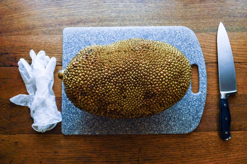 This is one of the largest fruits in the world! Called Jackfruit! My first time opening and eating one of these. You can only eat the pods raw. Though you can boil the seeds and they taste like sweet potatoes. The fruit itself tastes like a pineapple, banana and mango. Mmmmm. My particular Jackfruit weighed 20lbs! And cost me $20!!! High Angle View Food And Drink Indoors  Food No People Table Wood - Material Healthy Eating Freshness Directly Above Close-up Ready-to-eat Day Flatlay Still Life Jackfruit Large Huge Seeds Pods Sweet Exotic Exotic Fruit Aisia Fruit
