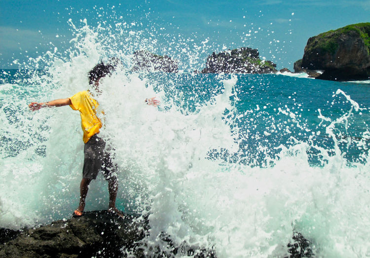 Sea Water attack ^_^ Siung Beach, Gunung Kidul, Yogyakarta, Indonesia. Water Sea Splashing One Person Motion Nature Sport Leisure Activity Lifestyles Real People Day Men Beauty In Nature Full Length Surfing Aquatic Sport Outdoors Adventure Power In Nature Swimming Pool EyeEm Best Shots Nature Beauty In Nature EyeEm Selects Enjoying Life This Is Strength This Is Strength Autumn Mood My Best Photo
