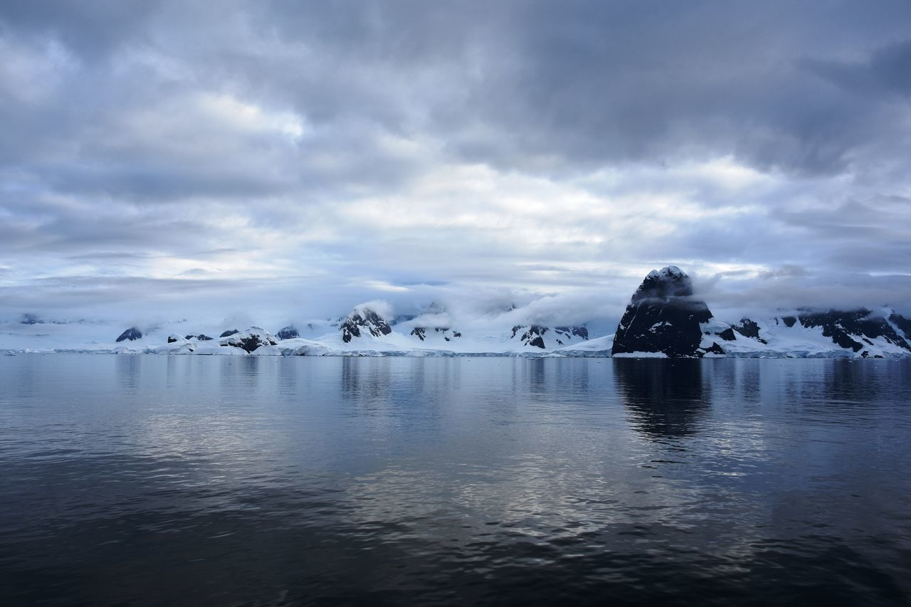 beauty in nature, tranquil scene, nature, tranquility, iceberg, scenics, ice, water, cold temperature, no people, frozen, waterfront, glacier, sky, rippled, outdoors, winter, cloud - sky, day, sea