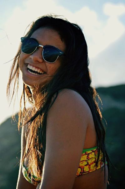 Sunglasses Smiling Portrait Beach Young Adult One Woman Only Long Hair Happiness Summer One Person Vacations Adult Adults Only Only Women Beauty Cheerful Beautiful Woman One Young Woman Only Day Outdoors