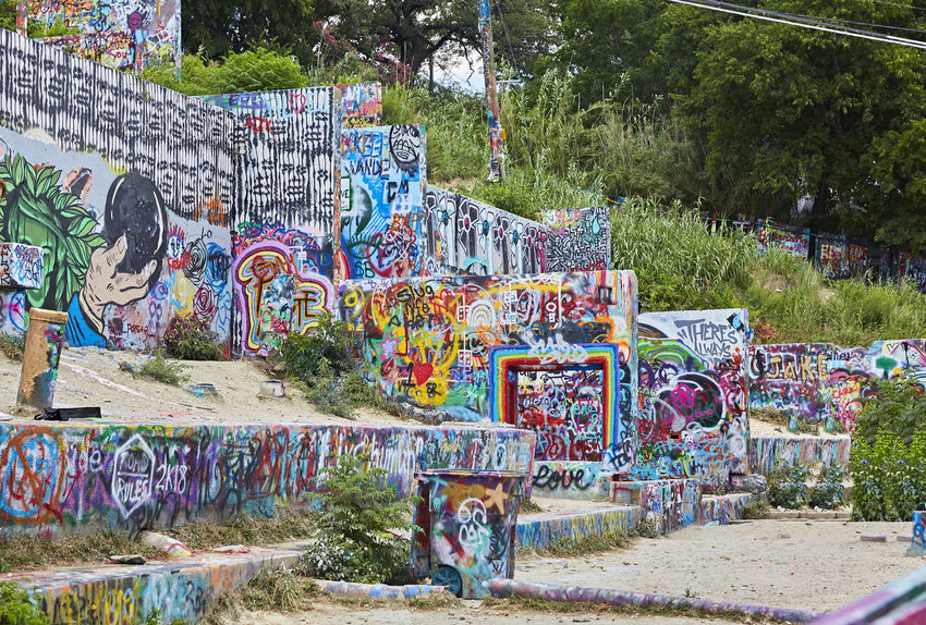 Castle Hill Austin2 Architecture Art And Craft Building Exterior Built Structure Communication Creativity Day Graffiti Multi Colored Mural Nature No People Outdoors Plant Street Art Tree Wall - Building Feature Western Script