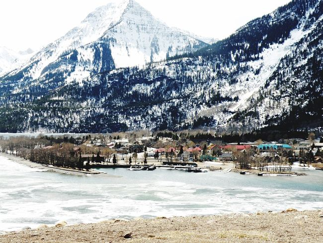 Waterton Mountain Snow Scenics Cold Temperature Mountain Range Winter Snowcapped Mountain Nature Beauty In Nature Outdoors Landscape Day Tranquility Built Structure Village Tranquil Scene No People Water Sky