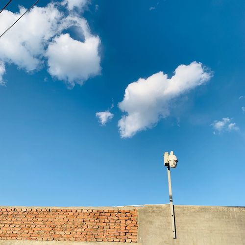 EyeEm Selects Sky Cloud - Sky Blue Nature Day Low Angle View No People Communication Architecture Tranquility Tranquil Scene Scenics - Nature Outdoors Sign Sunlight Text Beauty In Nature Technology Built Structure Western Script