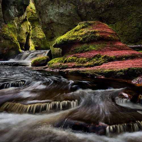 The Devil's Pulpit Red Sandstone Moss EyeEm Selects Glasgow  Scotlandsbeauty River Devils Pulpit Scotland Tree Water Motion Sky Waterfall Falling Water Power In Nature Natural Landmark Lightning Rock Formation Flowing Stream Countryside Flowing Water Long Exposure Growing Rushing Force